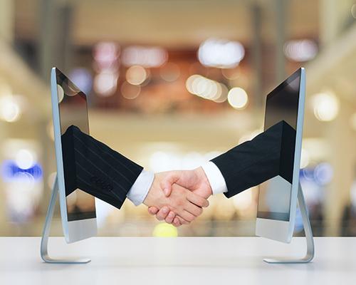 Virtual Office - Handshake between computer screens